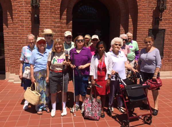 TSB Members and Sighted Guides stand in front of the Arizona State Museum posing for a group photo.