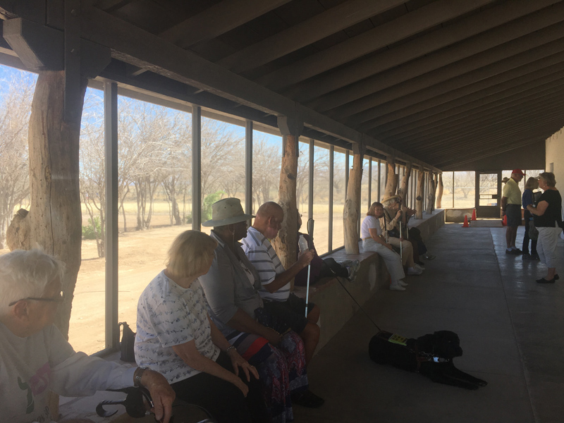 Members of TSB sit on the large front porch of the former Ranchers Home at the Historic Canoa Ranch.