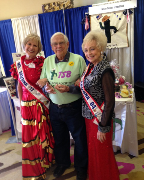 TSB member Mike stands with both the 2017 and 2004 Miss Arizona winners as they visit the organizations booth at the 2018 Tucson Expo.