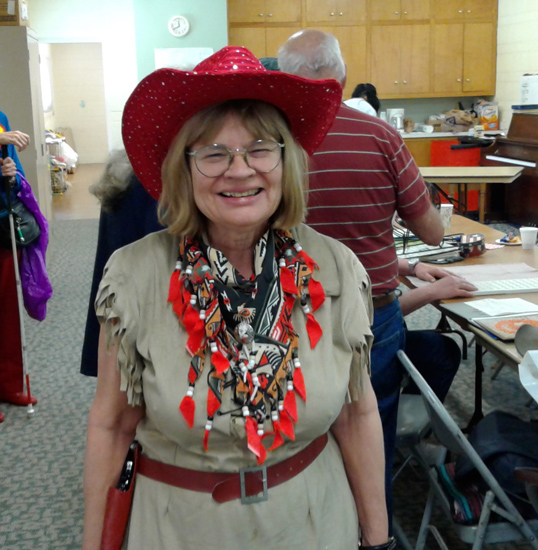 Barbara in her Annie Oakley costume with a sparkly red hat and big smile.