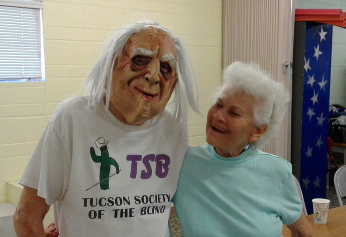 President Erma greeting ghostly Bill at TSB's Halloween 2016 Costume Party
