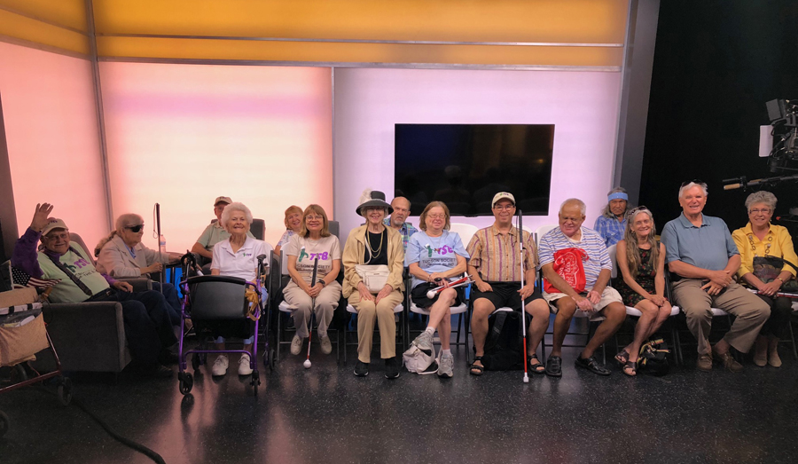 Members and volunteers with the Tucson Society of the Blind are seated for a group photo in preparation for the live viewing of the Morning Blend, a community focused program that airs on this ABC affiliate TV channel in Tucson.