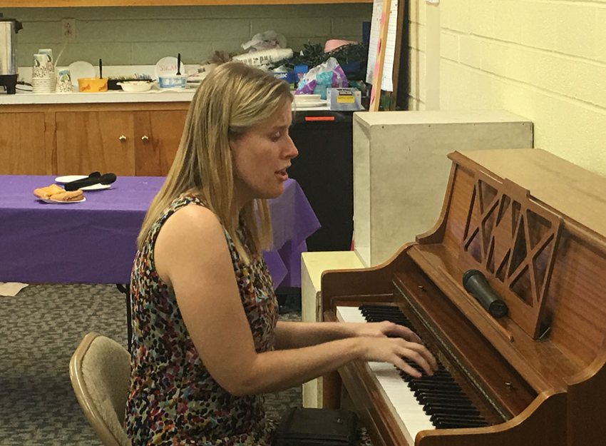 Lindsey McHugh plays the piano and sings for members of TSB at our weekly meeting.  She also spoke about techniques for teaching blind students music.