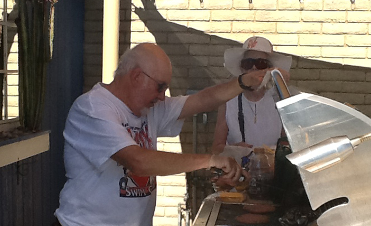 BBQ Chef Tom and helping hand Annie grilling up lunch at the Fall 2016 Pool Party