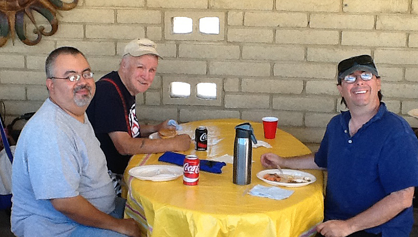Julio, Frank and Wesley enjoying lunch at the Fall 2016 Pool Party.