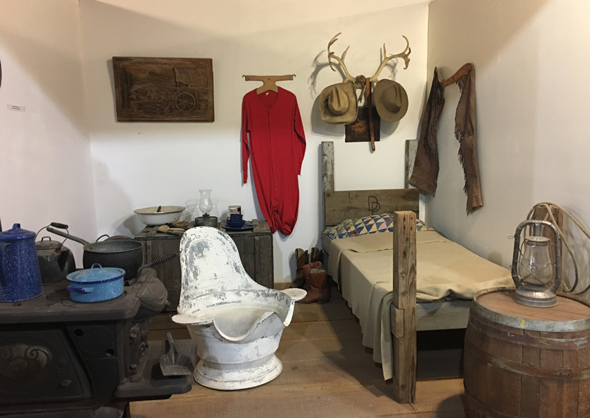 Function over luxury was of greater importance to most, with a small bed and wash tub found in this early south-west bedroom.