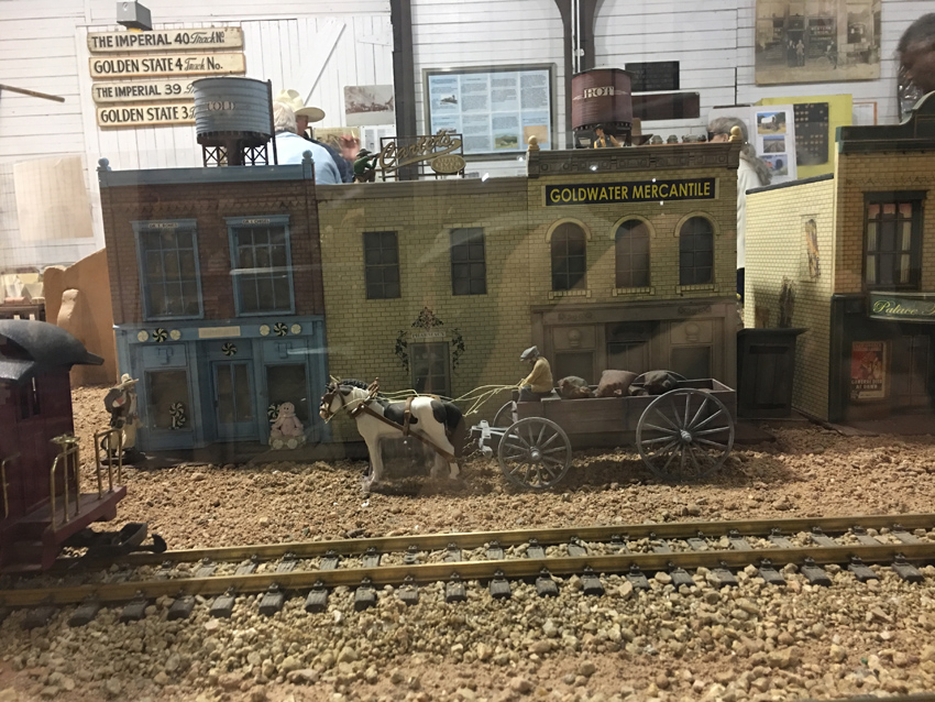Model trains and buildings of early Tucson.  Depicts downtown with horse and buggy carriage.