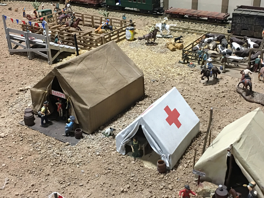 Model trains and buildings of early Tucson.  Depicts tent city east of downtown with Red Cross camp.