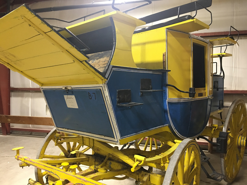Blue and yellow covered carriage.