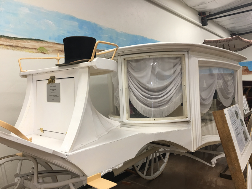 The Hearse, also known as the Funeral Carriage typically is black, but is white for children.
