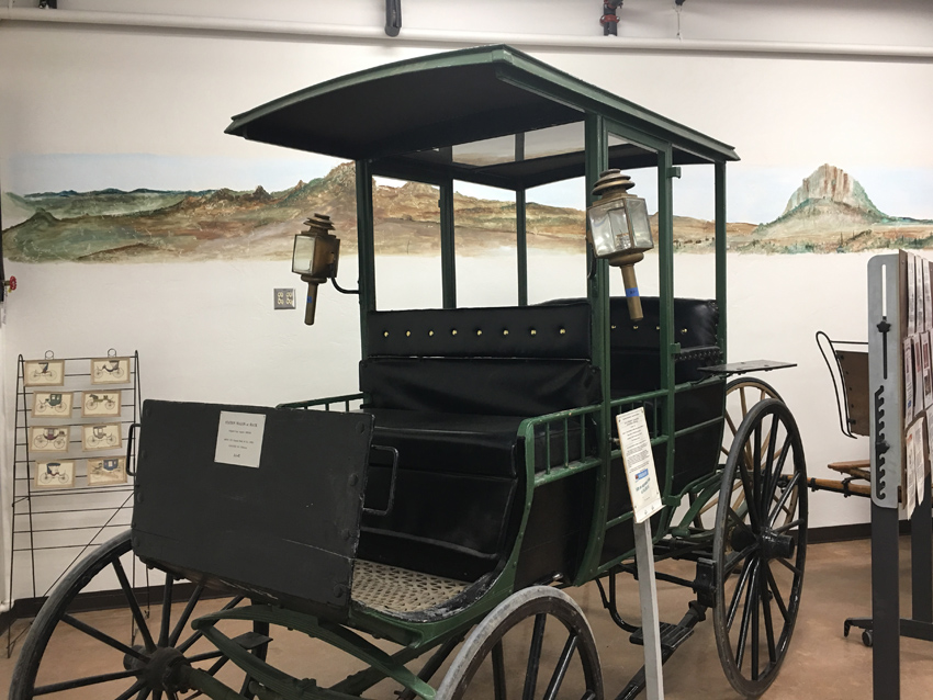Taxi's have served larger cities for hundreds of years, this black carriage provides privacy for riders in the back by offering a pull down screen.