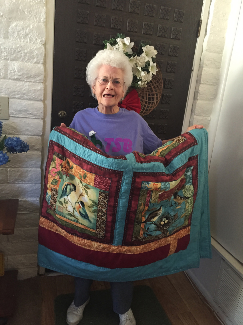TSB Fundraiser, Feb 2016, Irma with Quilt Auction Item.