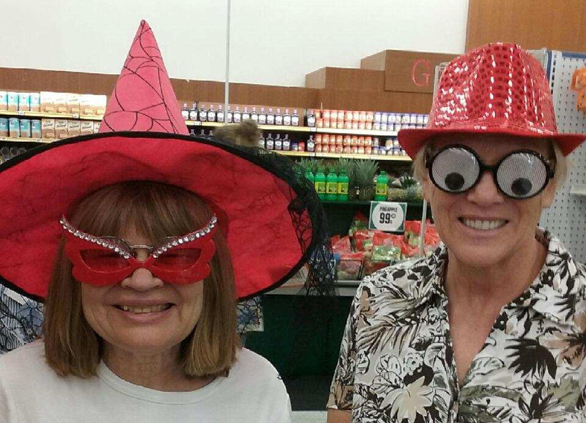 Barbara and Marilynn find hats, glasses, and masks perfect for a masquerade party at the Dollar Store