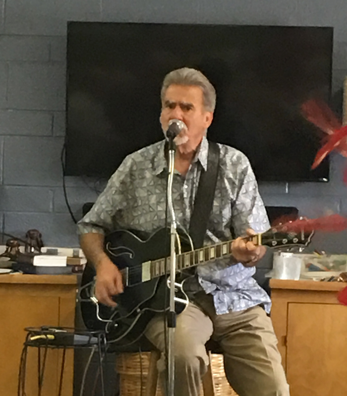 Tony sits on a stool playing his guitar while singing several favorites on Valentines Day 2017.